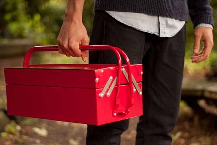 A man with red toolbox
